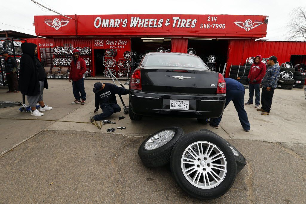A team of technicians replaced a set of tires and rims at Omar's Wheels and Tires in Dallas. The tire shop, owned by Omar Omar, was the scene of a murder in 2015.