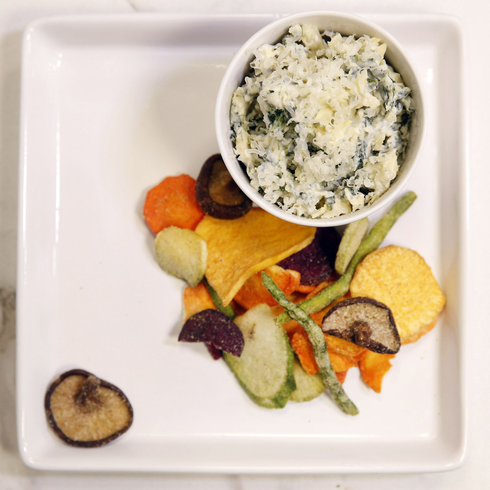 Houston's restaurant-style spinach and artichoke dip can be served with vegetable chips.