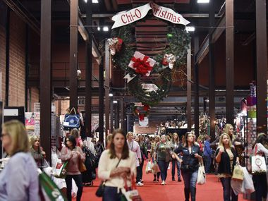 Shoppers walk the main market floor during the Chi Omega Christmas Market at Fair Park in Dallas last November. With an ongoing pandemic and related economic downturn, WalletHub has crunched the numbers on the maximum residents of various cities should be spending this holiday season.