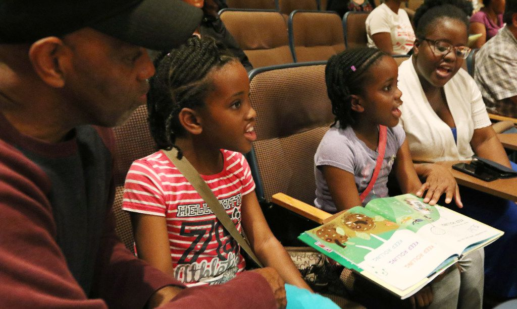Curtis Major (left), daughters Chelsea, 10, and Indie, 8, and wife Lisa spend a family day together at the Dallas Book Festival.