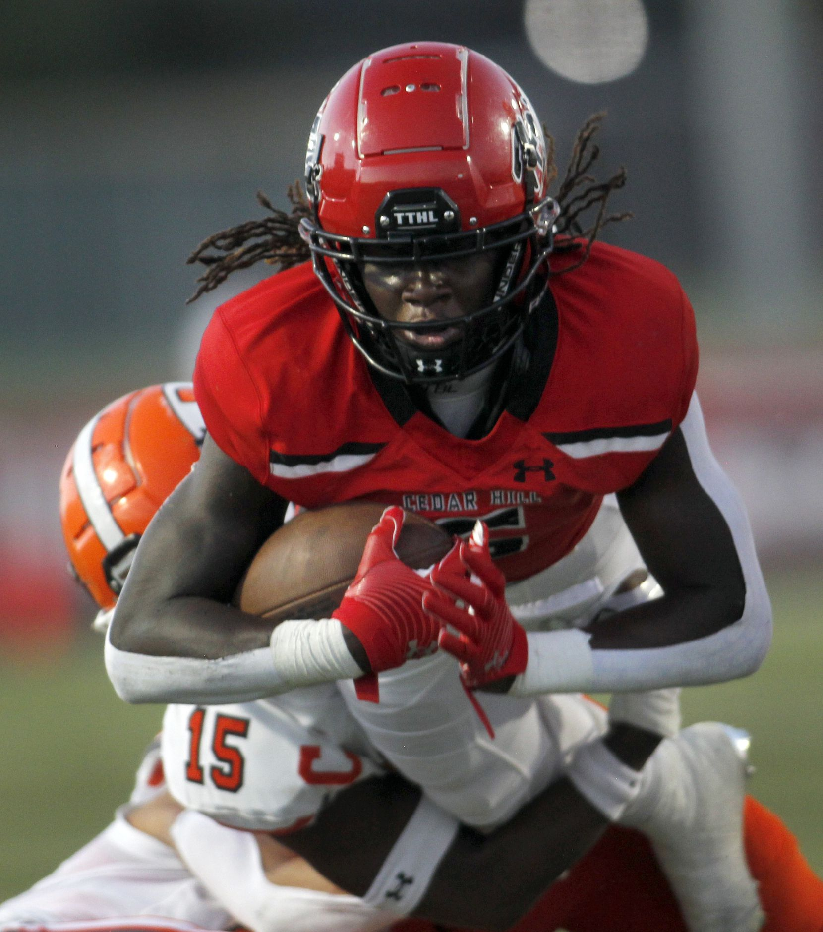 Cedar Hill running back Robert Richardson (6) dives near the goal line as he is stopped defensively by Rockwall linebacker Dayreck Dean (15) during a first half rush. Cedar Hill and Rockwall played their season opening football game at Longhorn Stadium in Cedar Hill on August 27, 2021. (Steve Hamm/ Special Contributor)