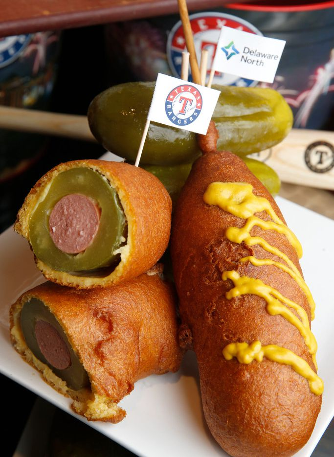 The dilly dog is offered as one of the Texas Rangers new menu items for the season at Globe Life Park in Arlington, Texas on March 26, 2018. (Nathan Hunsinger/The Dallas Morning News)