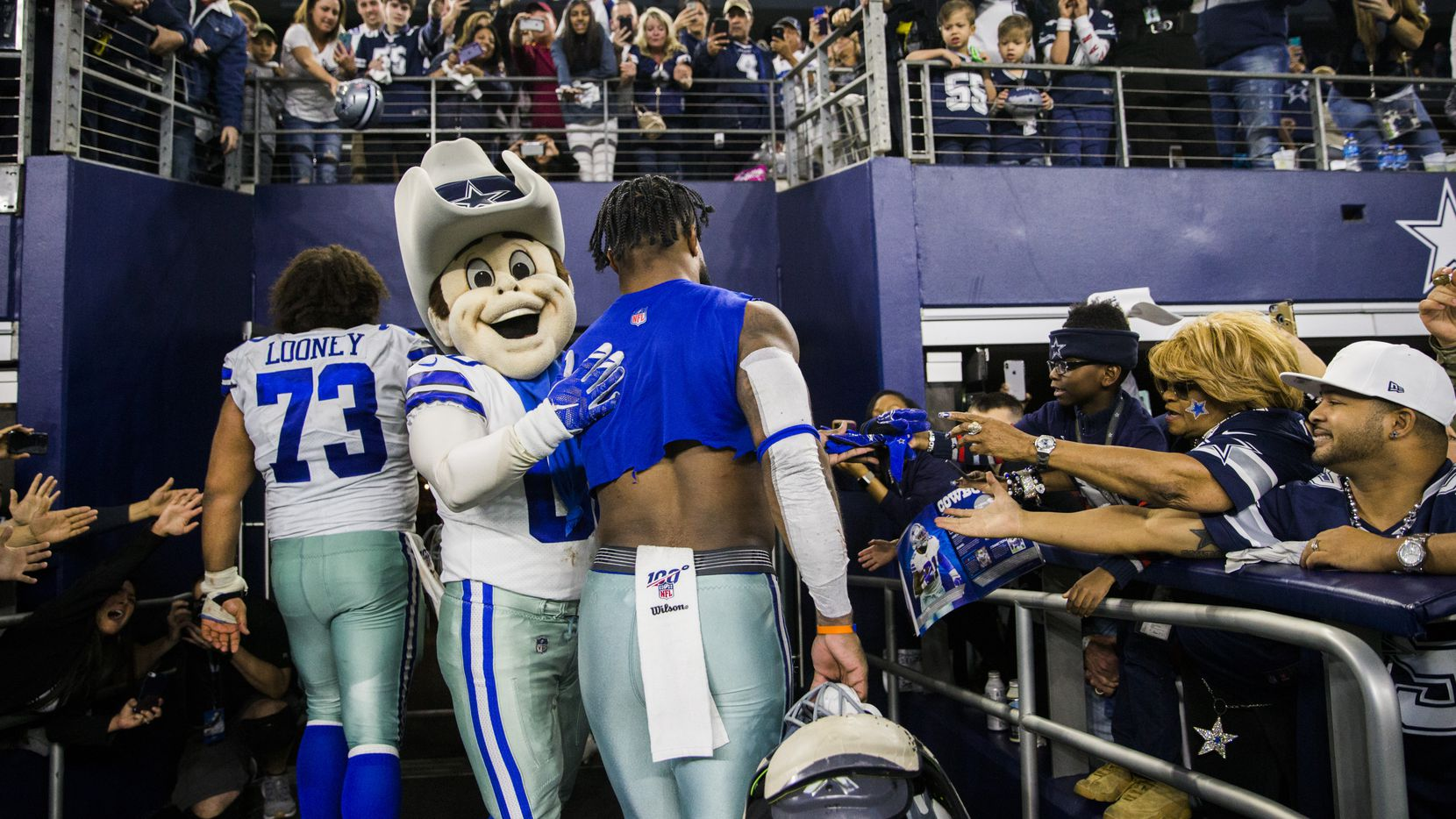 Dallas Cowboys mascot Rowdy pats running back Ezekiel Elliott (21) on the back as he and center Joe Looney (73) leave the field after an NFL game between the Dallas Cowboys and the Washington Redskins on Sunday, December 29, 2019 at AT&T Stadium in Arlington, Texas. (Ashley Landis/The Dallas Morning News)