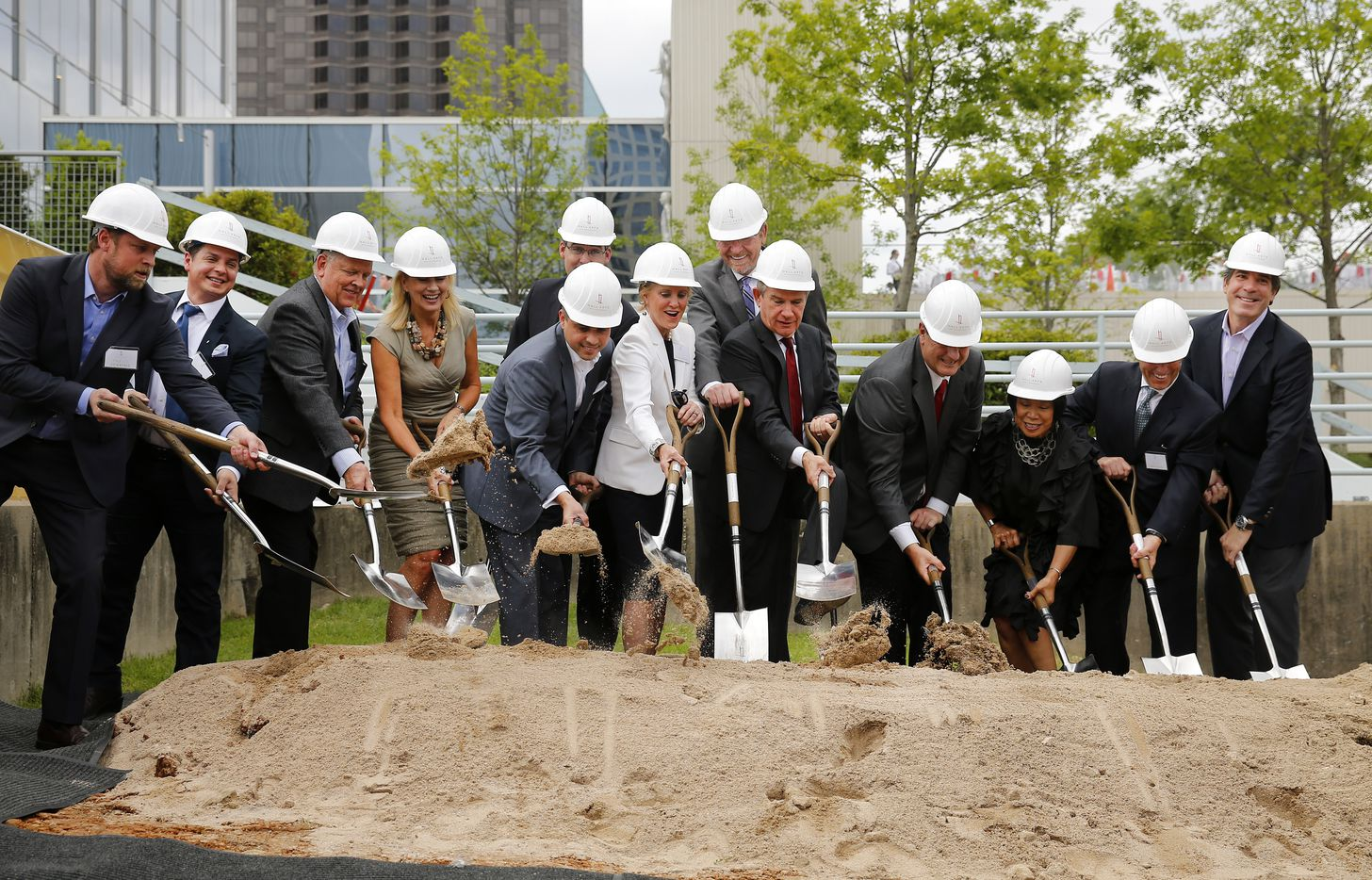 Hall Arts Hotel and Residences team members along with city and arts representatives shovel dirt to break ground on the Hall Arts Hotel and Residences.