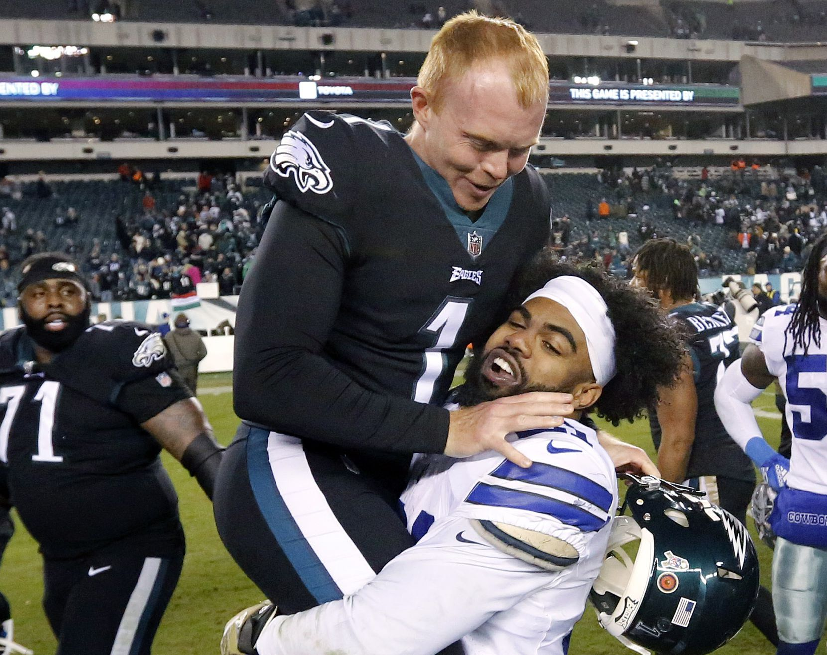 FILE - Dallas Cowboys running back Ezekiel Elliott (21) picks up Philadelphia Eagles punter and former Ohio St teammate Cameron Johnston (1) following their 27-20 win over the Eagles at Lincoln Financial Field in Philadelphia, Pennsylvania, Sunday, November 11, 2018. (Tom Fox/The Dallas Morning News)