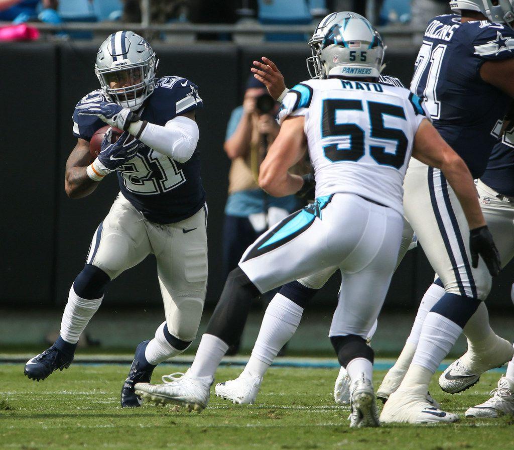 Dallas Cowboys running back Ezekiel Elliott (21) makes a break during the Dallas Cowboys 16-8 loss to the Carolina Panthers on Sunday, Sept. 9, 2018 at Bank of America Stadium in Charlotte, North Carolina. (Ryan Michalesko/The Dallas Morning News)