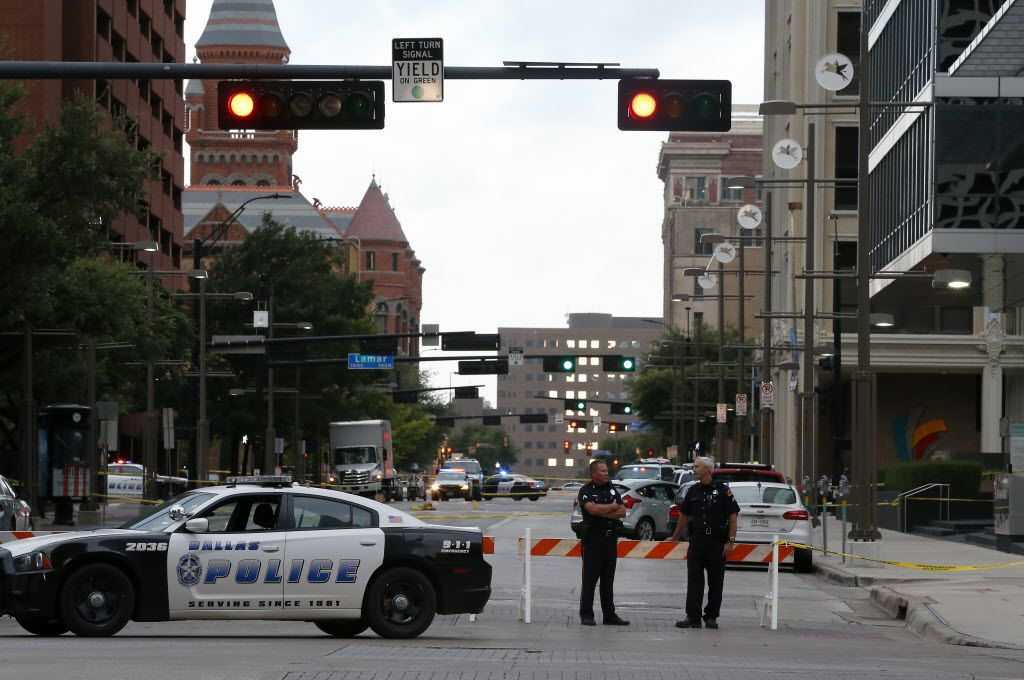 Dallas Police Department officers block Main Street near the El Centro College building in Dallas, Friday, July 8, 2016.