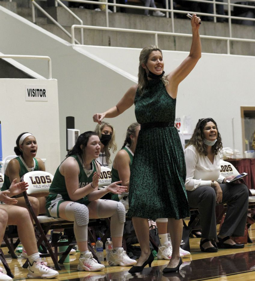 Southlake Carroll head coach Robyn McCoart encourages her players from the team bench area during first half action against Plano East. The two teams played their Class 6A regional semifinal girls playoff basketball game at Loos Field House in Addison on February 27, 2021. (Steve Hamm/ Special Contributor)