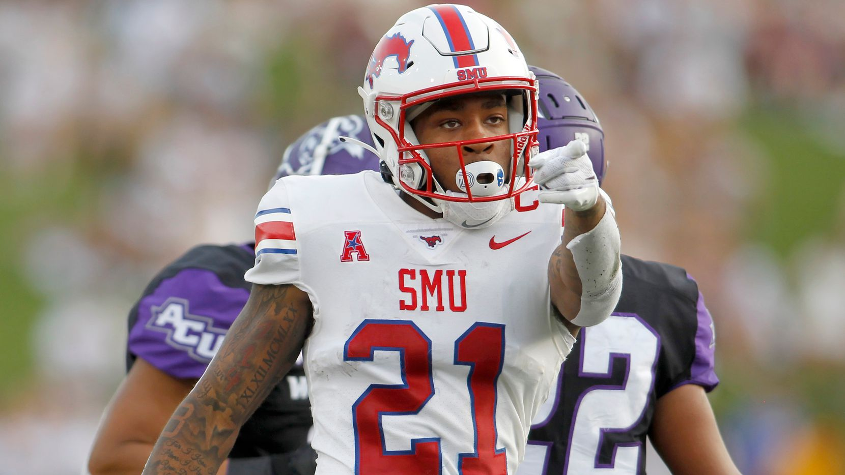 SMU receiver Reggie Roberson, Jr, (21) gestures after making a reception for a first down during first half action against Abilene Christian University. The two teams played their season opening football game at SMU's Ford Stadium in Dallas on September 4, 2021. (Steve Hamm/ Special Contributor)