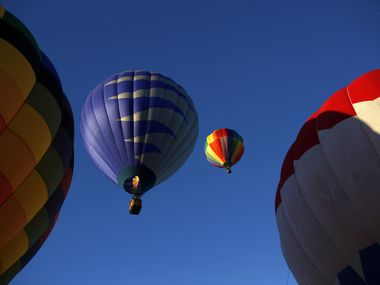 Hot air balloons take off during a balloon festival at Oak Point Park in Plano, in this file photo.