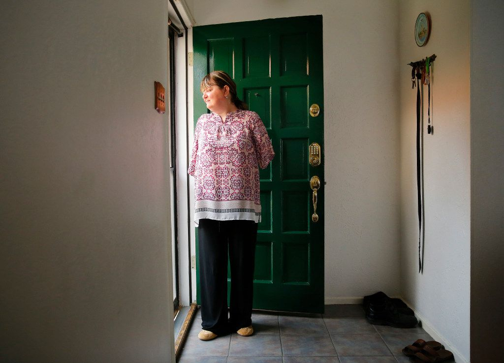 Belma Islamovic, a Bosnian refugee from over 20 years ago, lost both her arms in the war as pictured here in her Richardson apartment, Monday, February 6, 2017.