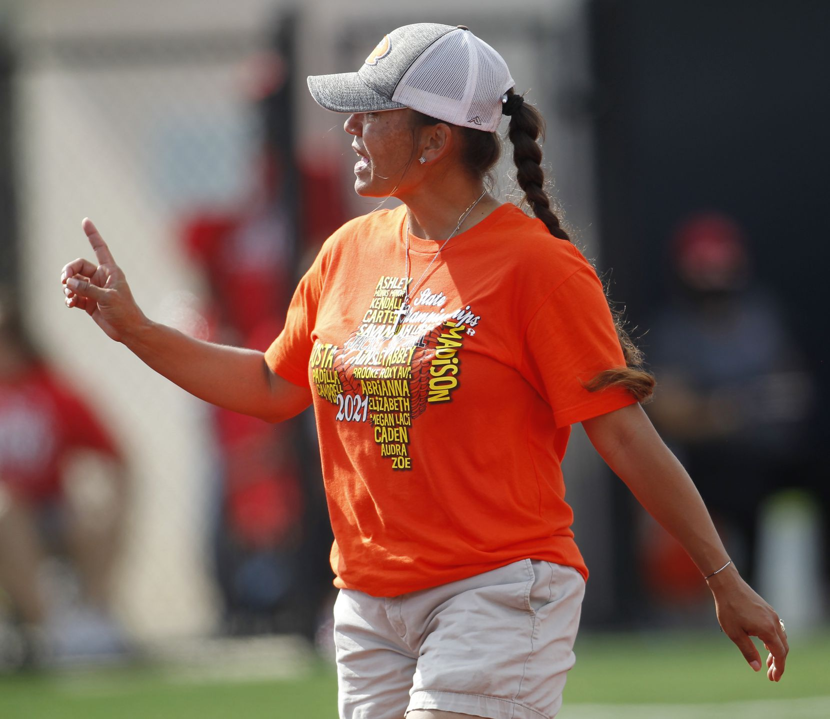 Rockwall head coach Shadie Acosta converses with the plate umpire after a mound visit during the bottom of the 4th inning against Converse Judson. The two teams played their UIL 6A state softball semifinal game at Leander Glenn High School in Leander on June 4, 2021. (Steve Hamm/ Special Contributor)