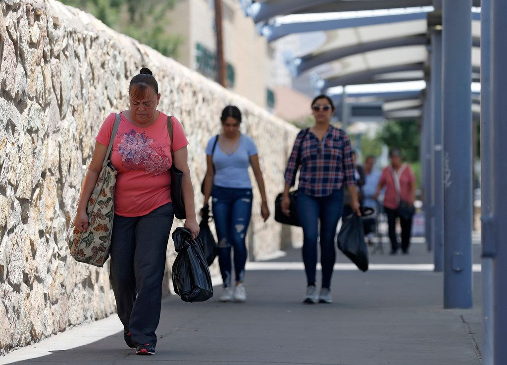 Laticia Hernandez walks back to Mexico after shopping in El Paso on Monday, August 5, 2019.