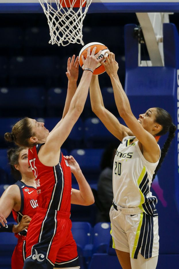 Washington Mystics forward Theresa Plaisance (55) and Dallas Wings forward Isabelle Harrison (20) jump for a rebound during the second quarter at College Park Center on Saturday, June 26, 2021, in Arlington. (Elias Valverde II/The Dallas Morning News)
