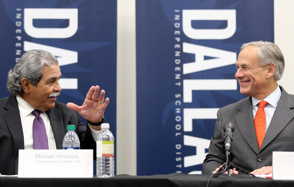 Dallas ISD Superintendent Michael Hinojosa, left, and Governor Greg Abbott meet with teachers and school administrators at Solar Preparatory School for Girls on Tuesday, August 21, 2018 in Dallas.
