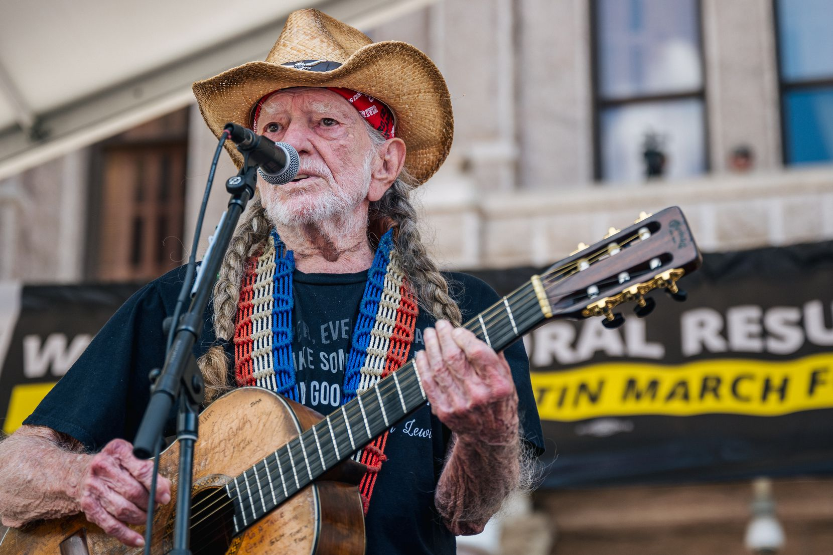 Musician Willie Nelson performed during the Georgetown to Austin March for Democracy rally on July 31, 2021 in Austin, Texas. Texas activists and demonstrators rallied at the Texas state Capitol after completing a 27-mile long march from Georgetown to Austin, demanding federal action on voting rights legislation. (Brandon Bell/Getty Images)
