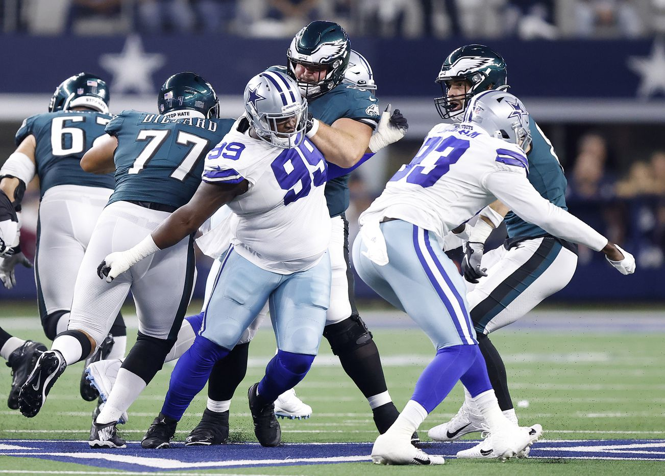 Dallas Cowboys defensive tackle Justin Hamilton (99) and defensive end Tarell Basham (93) take on the Philadelphia Eagles defense during the second quarter at AT&T Stadium in Arlington, Monday, September 27, 2021. (Tom Fox/The Dallas Morning News)
