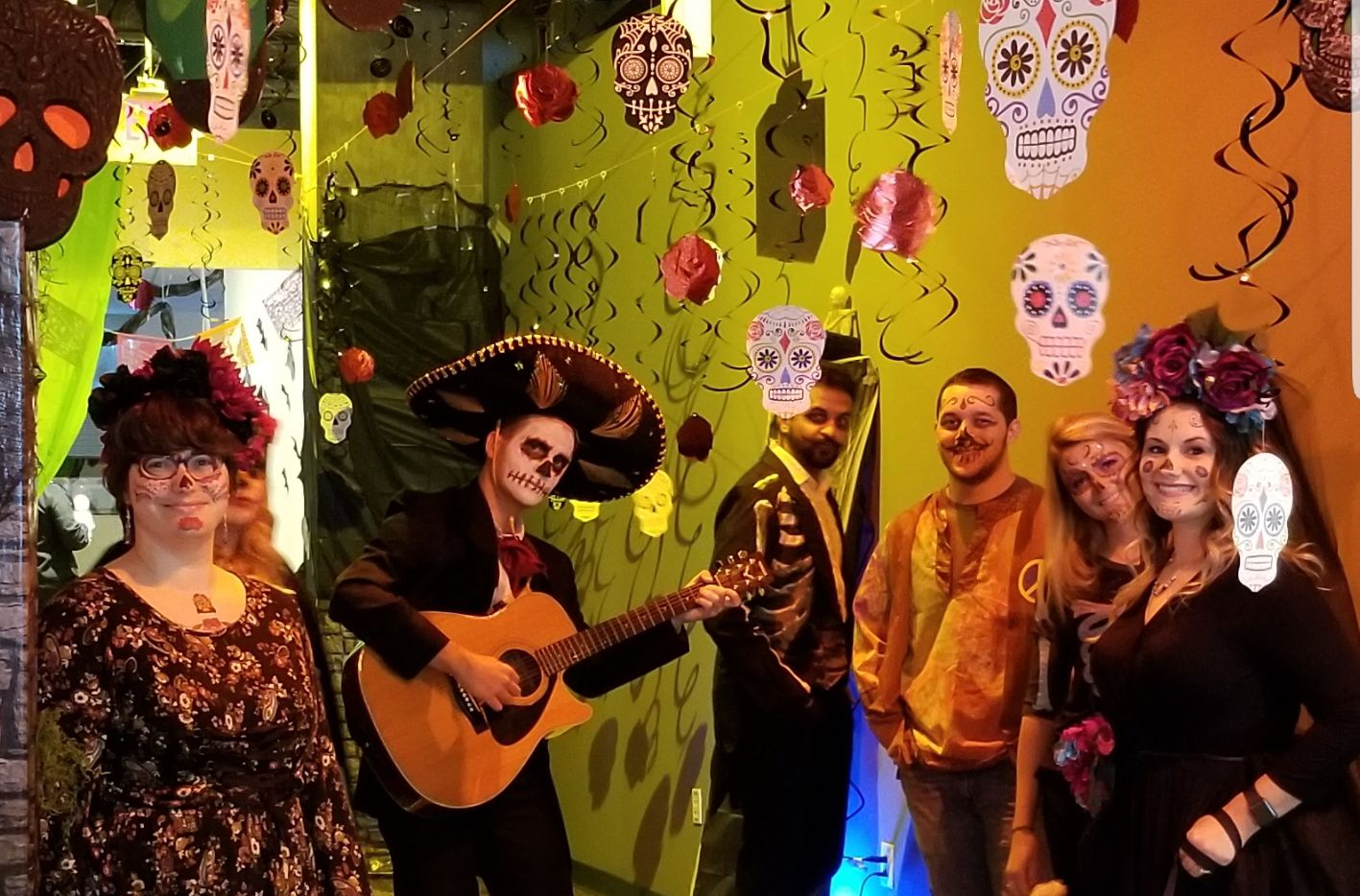 The information technology team won last year's Halloween contest at WebTPA, an AmWINS Group Co. in Irving. Corbin Greer, one of the company's operation analysts, is holding the guitar surrounded by developers, programmers and analysts.