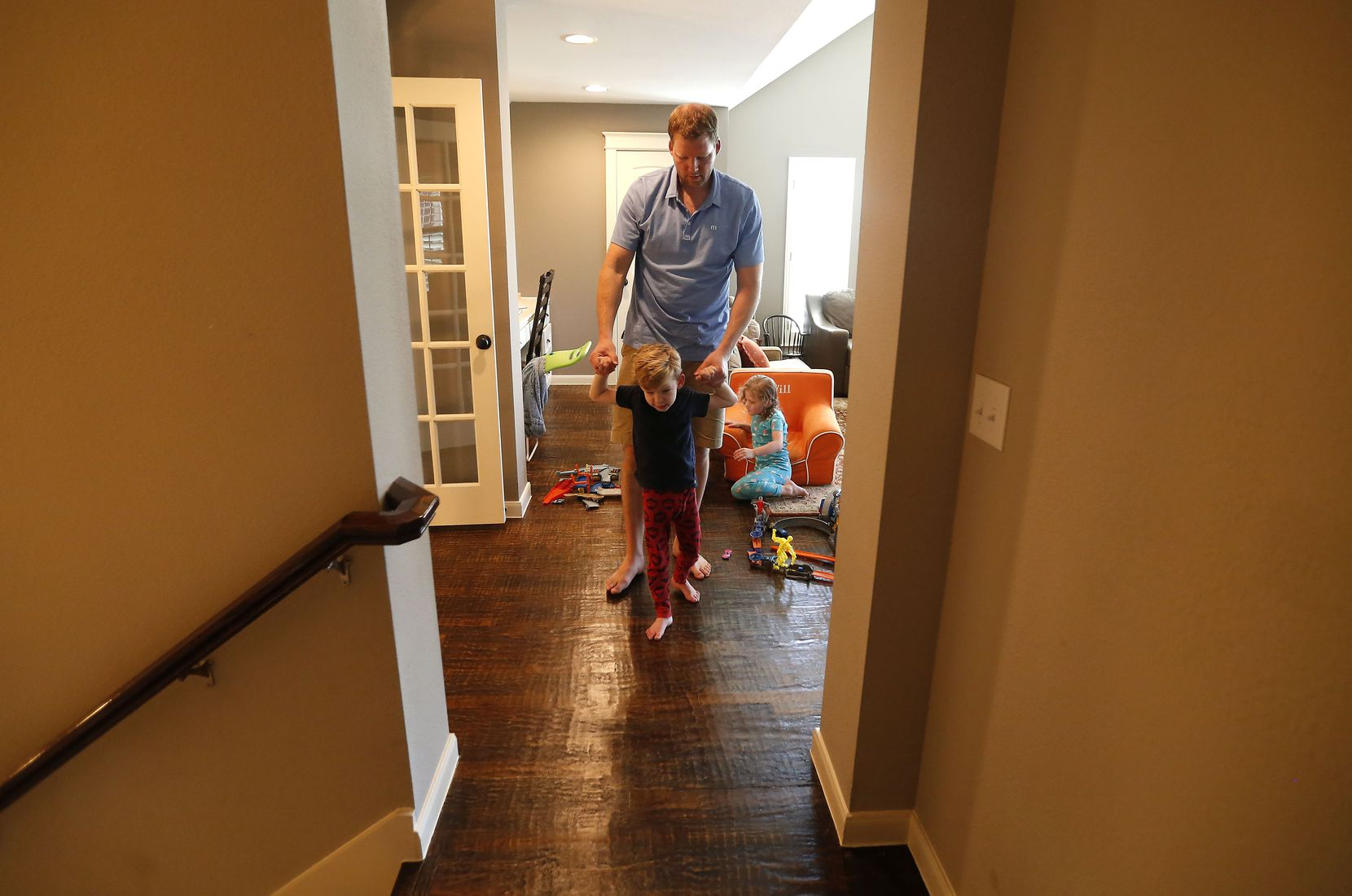 Doug Woleben helps his son, Will, walk to his bedroom at their home in McKinney, Texas, Wednesday, June 20, 2018.
