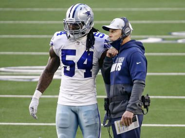 Dallas Cowboys middle linebacker Jaylon Smith (54) checks in with defensive coordinator Mike Nolan during the second quarter against the San Francisco 49ers at AT&T Stadium in Arlington, Texas, Sunday, December 20, 2020.