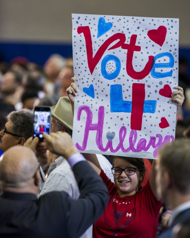 A supporter holds up a sign before Democratic presidential candidate Hillary Clinton at Mountain View College in Dallas. Clinton is running a tight race with Republican Donald Trump in Texas.