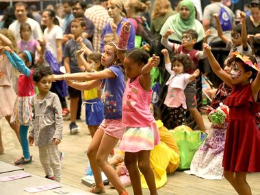 Children dance during a demonstration by the Dynasty Dance Academy during the Families First Fall Fair at the Plano Event Center in 2018.