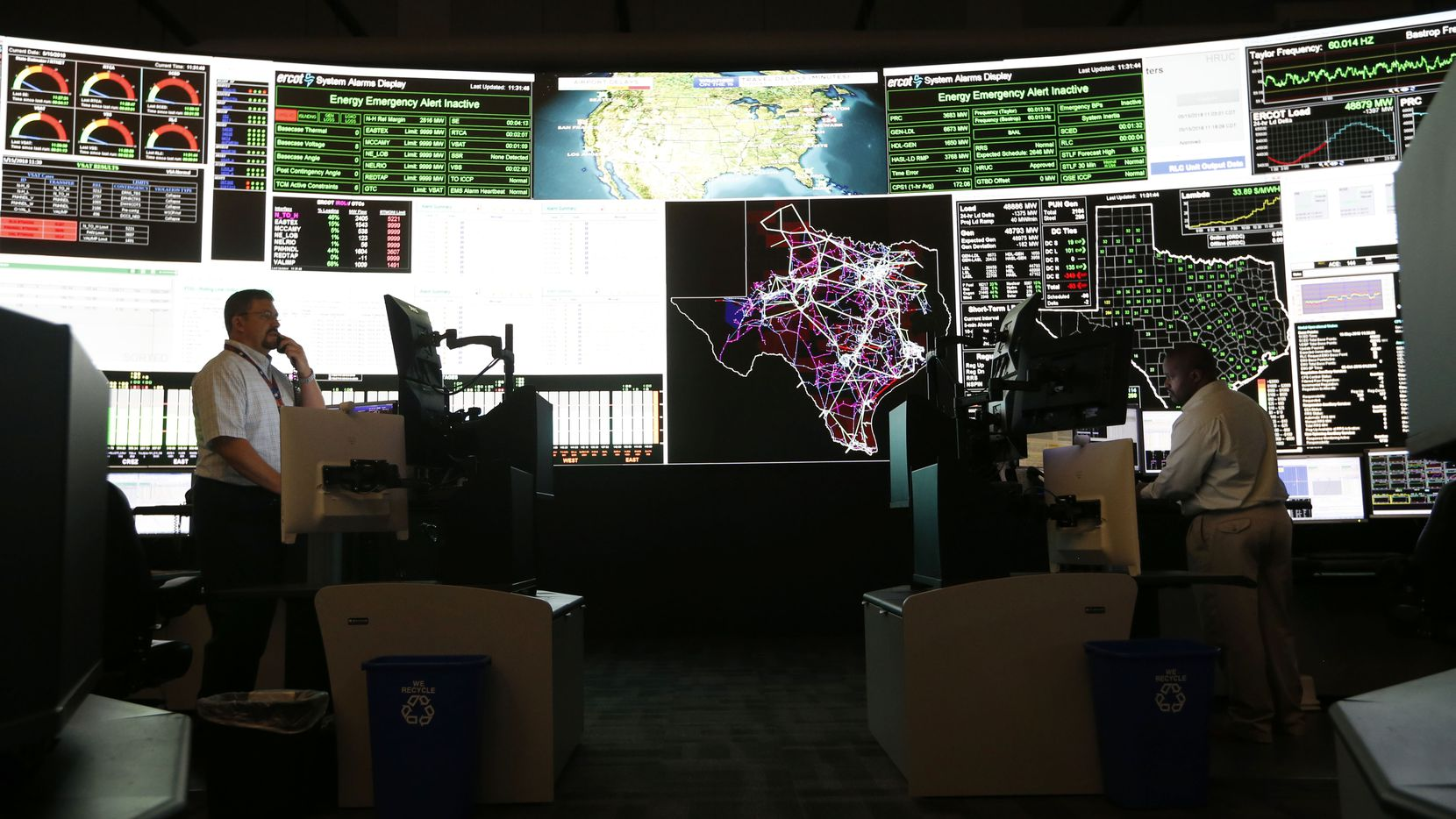 "System operators in the command center of the Electric Reliability Council of Texas in Taylor, shown in a 2018 file photo, should be considered among the essential workers who get COVID-19 shots early, council president and chief executive Bill Magness wrote to a state vaccine distribution panel. ""These workers keep the power flowing to critical customers such as hospitals and emergency facilities and their responders, and all other Texans located within the ERCOT footprint,"" he said."