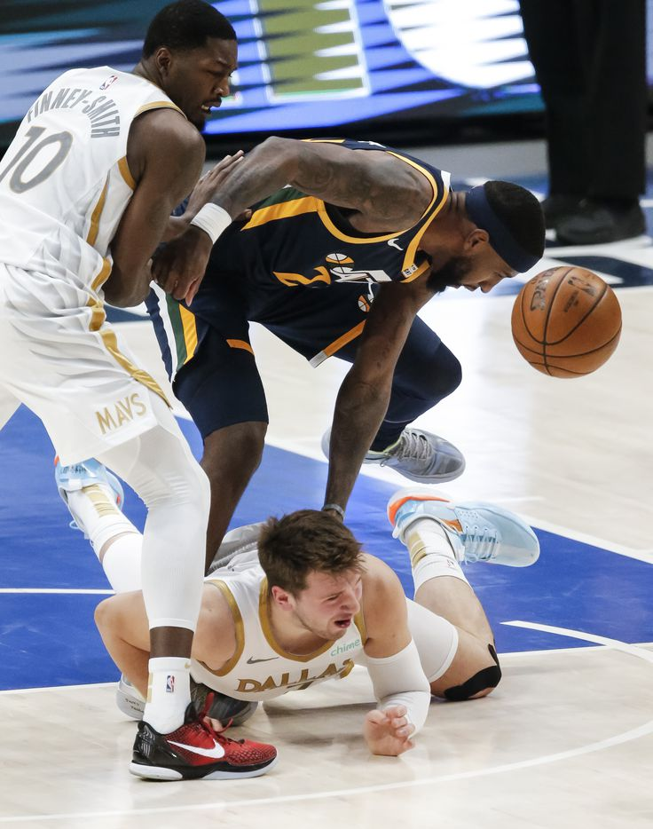 Dallas Mavericks forward Dorian Finney-Smith (10) and guard Luka Doncic, bottom, battle Utah Jazz guard Trent Forrest (3) for a loose ball during the first half of an NBA basketball game in Dallas, Monday, April 5, 2021. (Brandon Wade/Special Contributor)