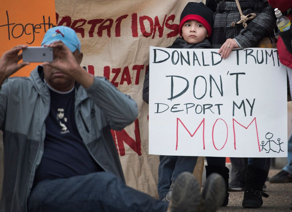 A young boy with his mother attend a rally in front of the White House in February organized by United We Dream, an immigrant youth-led organization protesting raids nationwide.