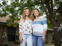 "North Garland High School senior Gabriella Munoz, left, and her mom, Karen, pose outside their home in Rowlett, Sunday, October 18, 2020. Gabriella struggled with remote learning last spring and said, ""It's not as good as in person, it's really hard to focus."""