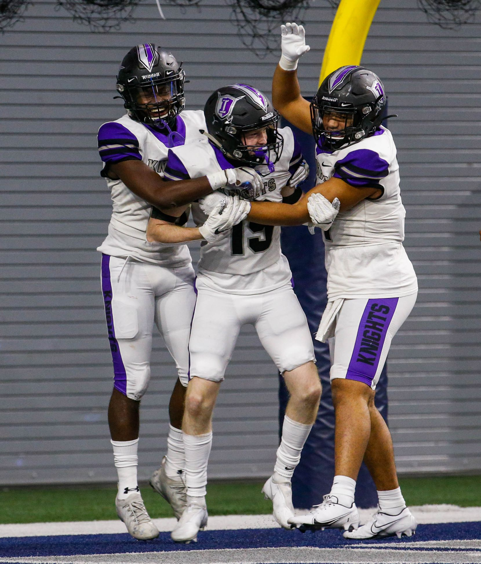 Frisco Independence Ryan Pickering (19) celebrates with teammates after scoring a touchdown against Frisco Heritage during the second half of a game at the Ford Center at the Star in Frisco on Thursday, Dec. 3, 2020. (Juan Figueroa/ The Dallas Morning News)