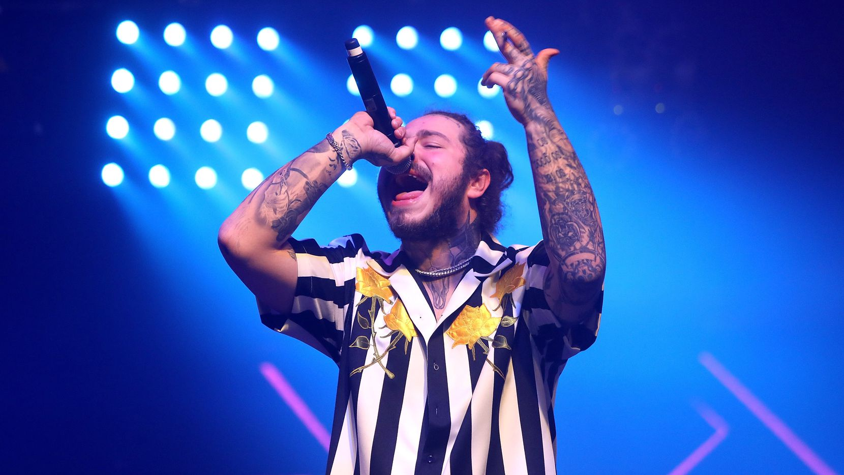 Post Malone performs onstage at the 2018 Billboard Music Awards official afterparty at Hakkasan Nightclub on May 20, 2018 in Las Vegas, Nev.  LAS VEGAS, NV - MAY 20:  Post Malone performs onstage at the 2018 Billboard Music Awards official after party at Hakkasan Nightclub presented by Security Benefit at MGM Grand Hotel & Casino on May 20, 2018 in Las Vegas, Nevada.  (Photo by Roger Kisby/Getty Images for Dick Clark Productions) ORG XMIT: 775164601