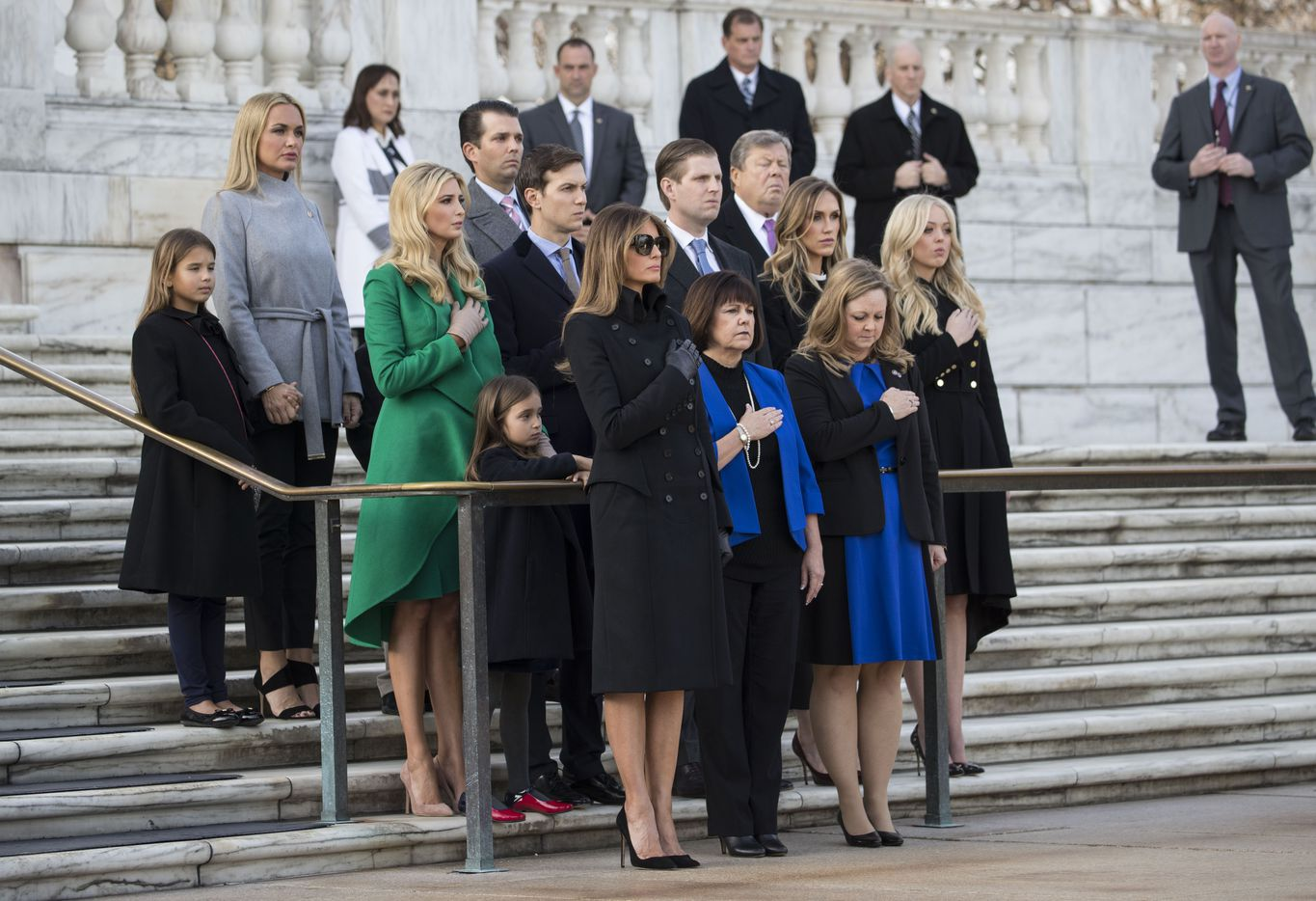 The families of Donald Trump and Mike Pence look on as the president-elect and vice president-elect left a wreath at the Tomb of the Unknowns, at Arlington National Cemetery in Arlington, Va., Jan. 19, 2017. In the front row at left is Melania Trump; next to her is Karen Pence.