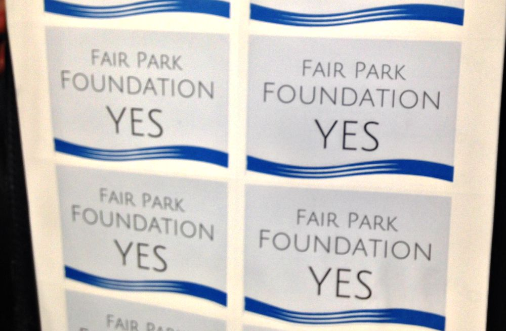 Craig Holcomb, a former council member and president of the Friends of Fair Park, was handing out these stickers before Thursday's meeting.