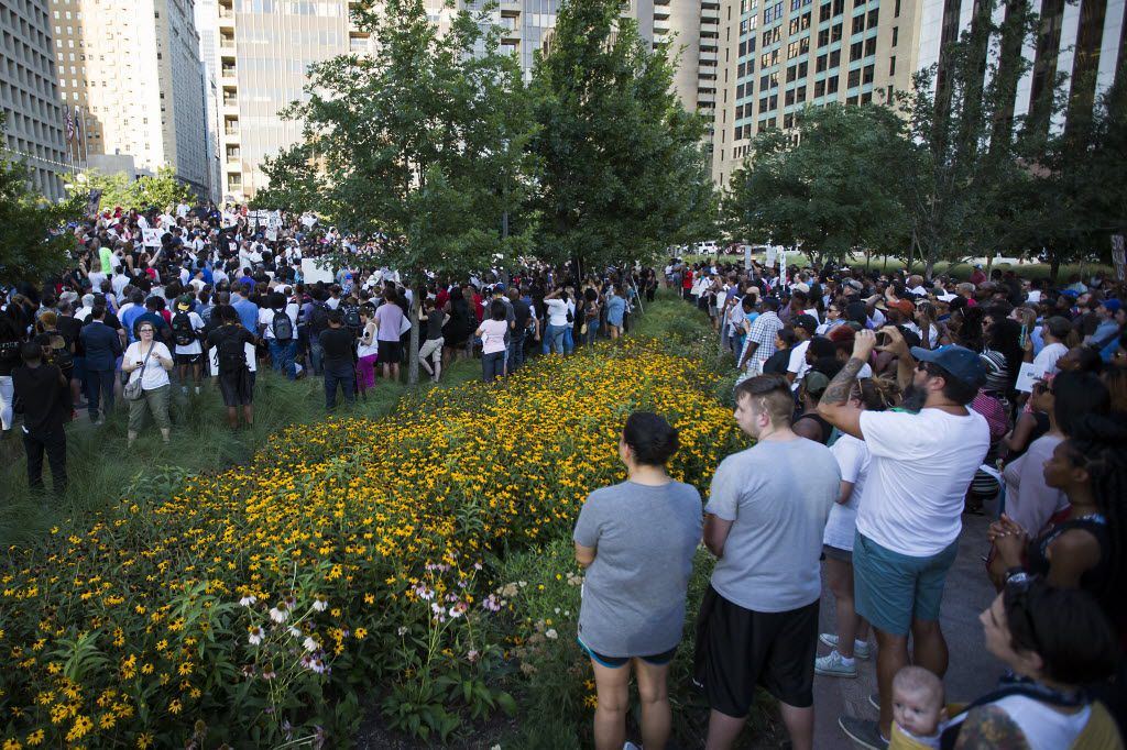 Protestors fill Belo Garden for a rally in downtown Dallas on Thursday, July 7, 2016. Dallas protestors rallied in the aftermath of the killing of Alton Sterling by police officers in Baton Rouge, Louisiana and Philando Castile, who was killed by police less than 48 hours in Minnesota. (Smiley N. Pool/The Dallas Morning News)