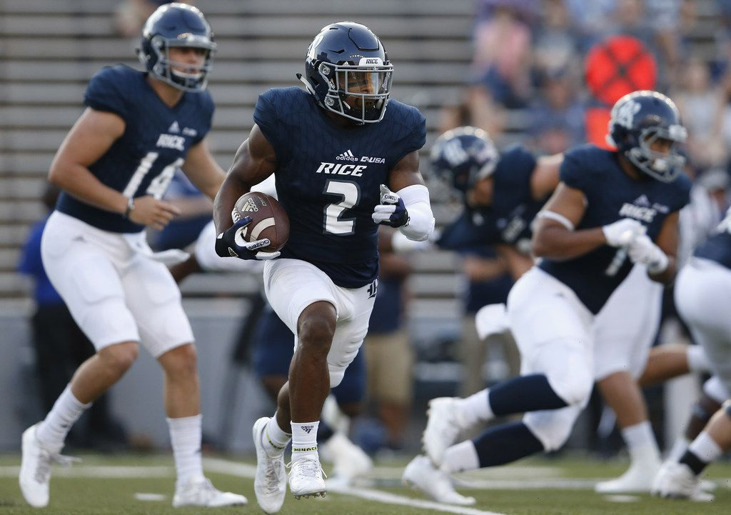 HOUSTON, TX - SEPTEMBER 23:  Austin Walter #2 of the Rice Owls runs the ball in the first quarter against the FIU Golden Panthers at Rice Stadium on September 23, 2017 in Houston, Texas.