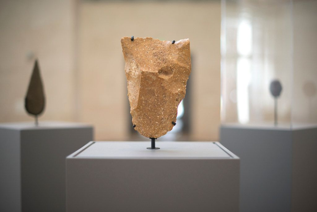 A quartzite cleaver, found in Mauritania and exhibited at '€œFirst Sculpture'€ at the Nasher Sculpture Center