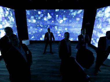 "Guests get a 360-degree experience utilizing touchscreen technology and high-definition projection inside the ""X Room"" of the Collaboration Center during an open house event at NTT Data's North American headquarters in Plano, Texas, Wednesday, Nov. 15, 2017."