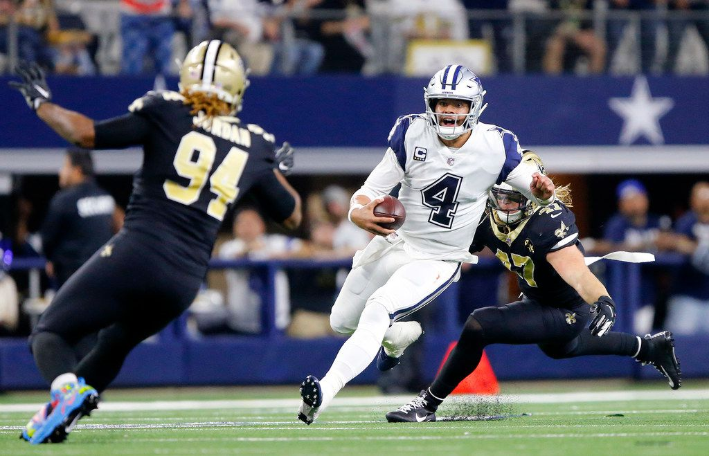 FILE - Cowboys quarterback Dak Prescott (4) takes off running in the second quarter of a game against the New Orleans Saints at AT&T Stadium in Arlington on Thursday, Nov. 29, 2018.
