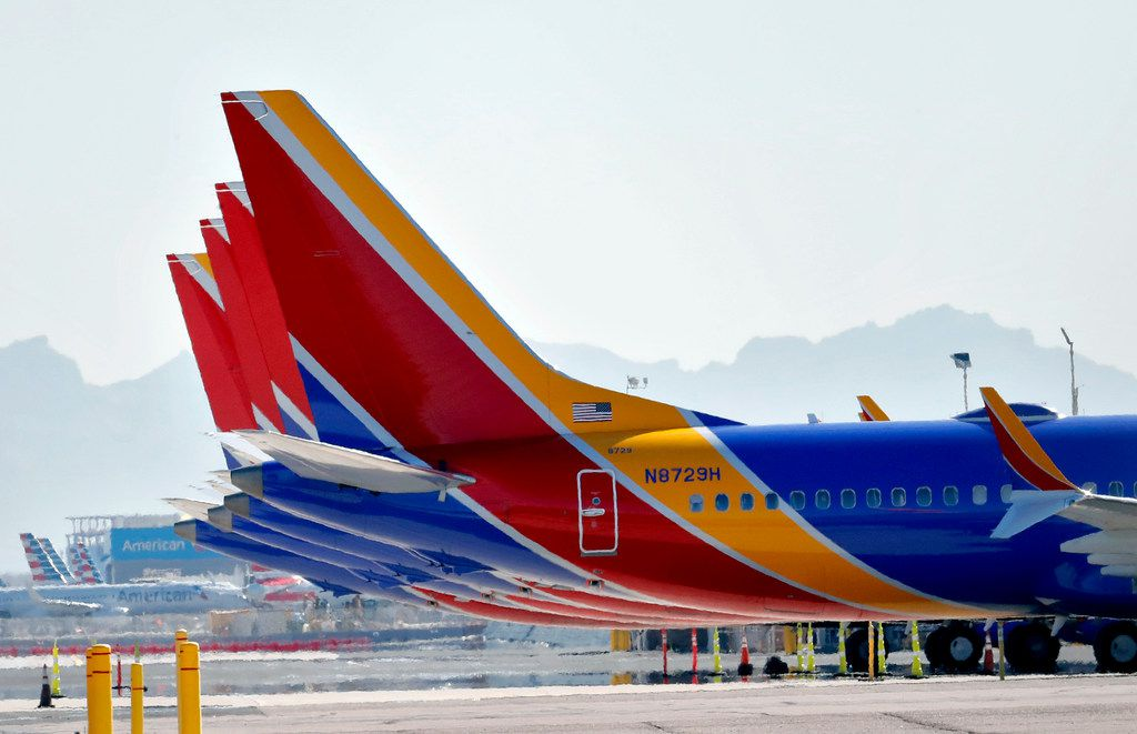 Southwest Airlines Boeing 737 Max jets are grounded at Sky Harbor International Airport, Thursday, March 14, 2019 in Phoenix. The U.S. issued an immediate emergency order Wednesday, grounding all 737 Max 8 and Max 9 aircraft in the wake of the crash of an Ethiopian Airliner. (AP Photo/Matt York)