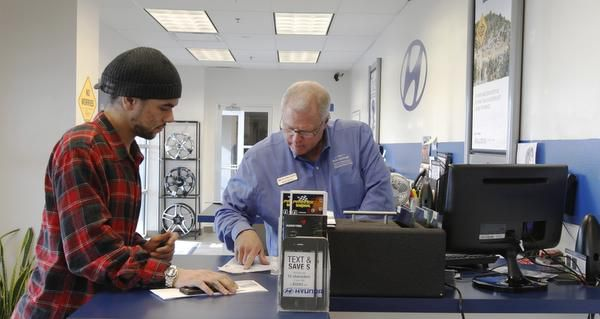 Jared Freeman (left) gets help from Keith Archer of the Bob Stallings Hyundai service department.