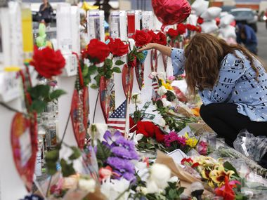 Gloria Garces of El Paso mourns for the loss of 2 family members at a makeshift memorial for victims at a shopping complex near the Walmart of a mass shooting in El Paso, Texas on Tuesday, August 6, 2019. 22 people were shot and killed and numerous others were injured in a mass shooting at a Walmart in El Paso on Saturday. (Vernon Bryant/The Dallas Morning News)