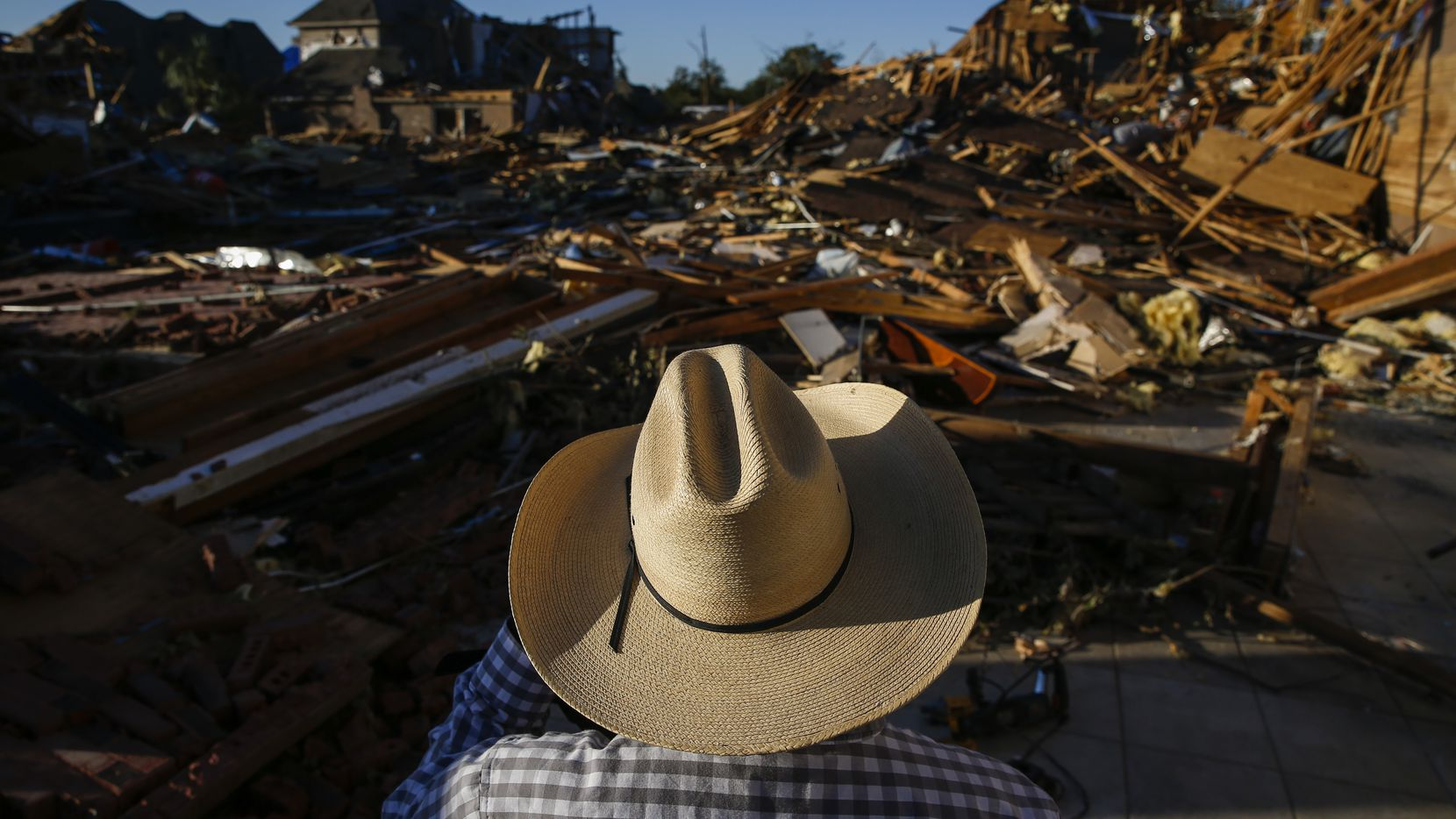 Hector Rodriguez, who has served as Deacon of Primera Iglesia Bautista Mexicana since 1987, surveys damage at the church just off of Walnut Hill Lane in Dallas, on Monday, Oct. 21, 2019 after a tornado hit the night before. (Ryan Michalesko/The Dallas Morning News)