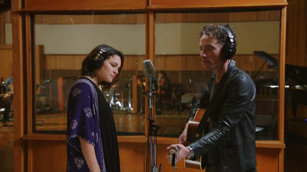 """Norah Jones and Jakob Dylan sing """"Never My Love"""" during the movie, Echo in the Canyon."""