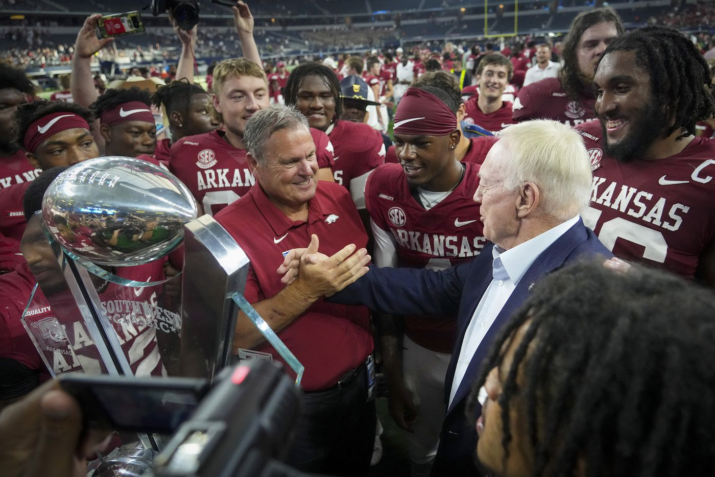 Dallas Cowboys owner and general manager Jerry Jones (right) congratulates Arkansas head coach Sam Pittman after a victory over Texas A&M in an NCAA football game at AT&T Stadium on Saturday, Sept. 25, 2021, in Arlington. Arkansas, Jones alma mater, won the game 20-10.