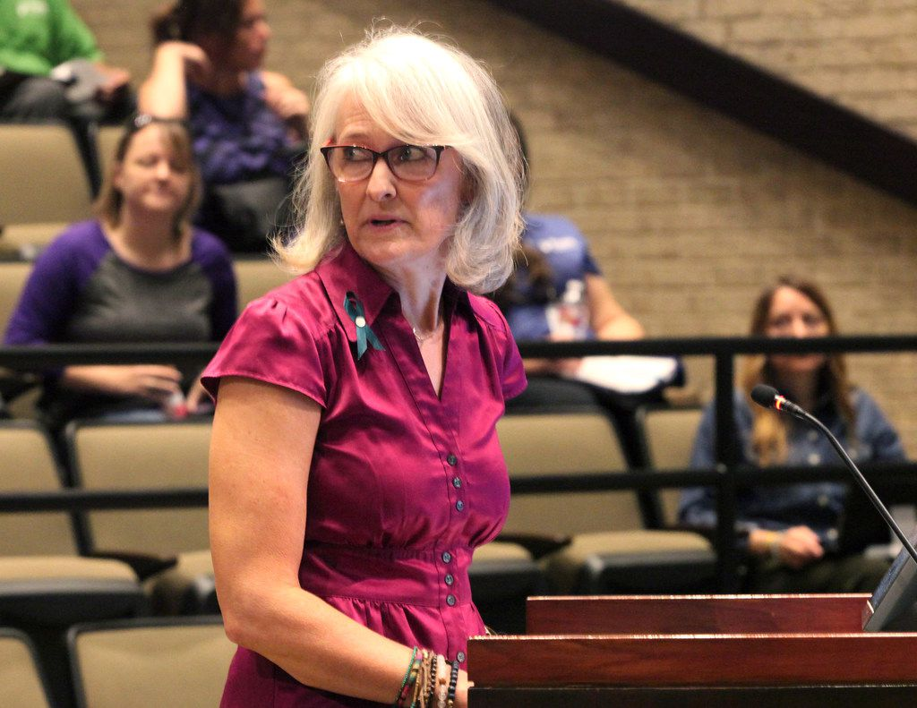 Wendy Hanna, executive director of The Turning Point, speaks from the podium at the Plano City Council work session Saturday, Aug. 17, 2019.