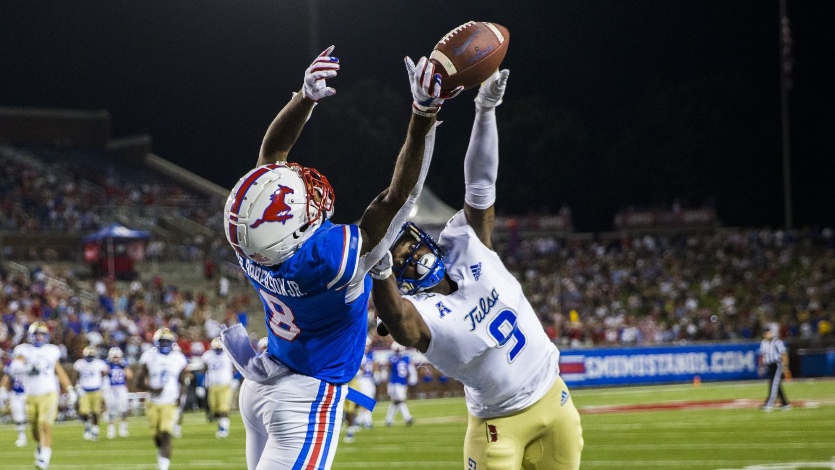 SMU Mustangs wide receiver Reggie Roberson Jr. (8) misses a pass with Tulsa Golden Hurricane cornerback Reggie Robinson II (9) in the end zone during the second quarter of an NCAA football game between Tulsa and SMU on Saturday, October 5, 2019 at Ford Stadium.