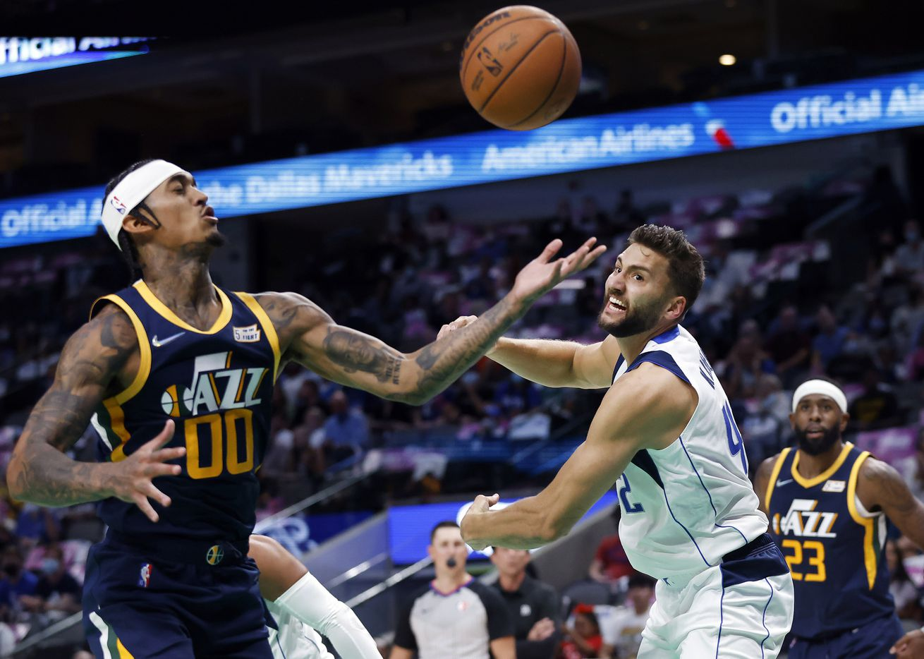 Dallas Mavericks forward Maxi Kleber (42) tries to regain control of a rebound as Utah Jazz guard Jordan Clarkson (00) looks to capture it during the first half at the American Airlines Center in Dallas, Wednesday, October 6, 2021.(Tom Fox/The Dallas Morning News)
