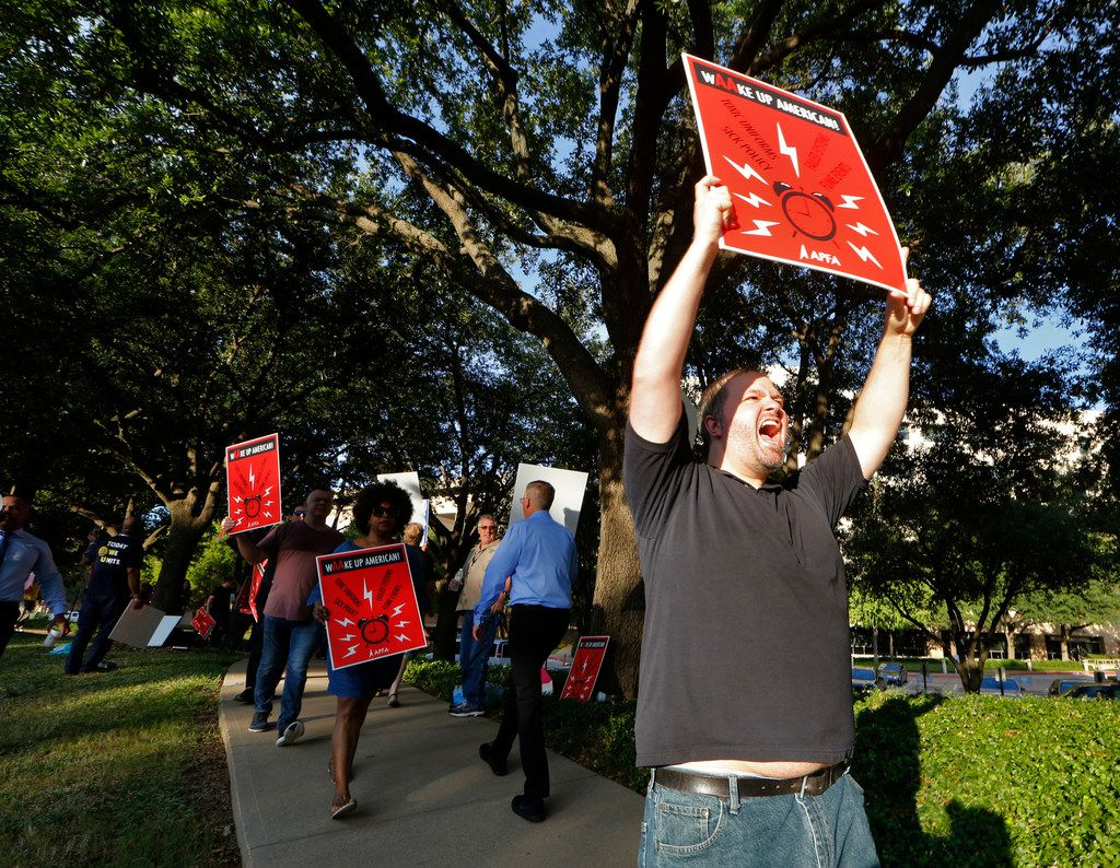 Josh Fitzgerald pickets with flight attendants outside American Airlines headquarters in Fort Worth on Thursday. The union is calling attention to a number of their complaints, including uniforms, scheduling and sick leave policy.