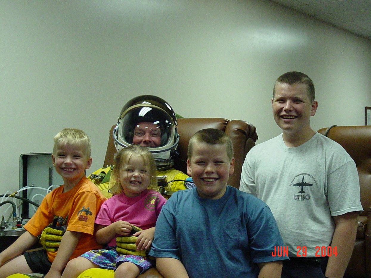 """Greg """"Spanky"""" Barber (center) prepares for a U2 flight with his children Tim (left), Becca, Ben (second from right) and Franklin."""